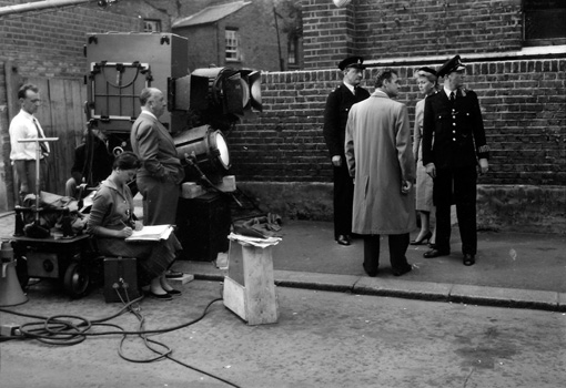 Connie Willis (seated, left) working as continuity 'girl' on the set of THE MAN WHO KNEW TOO MUCH (1956), directed by Alfred Hitchcock (standing next to the camera) and co-starring Doris Day (standing, right). Photo courtesy of The Cinema Museum.