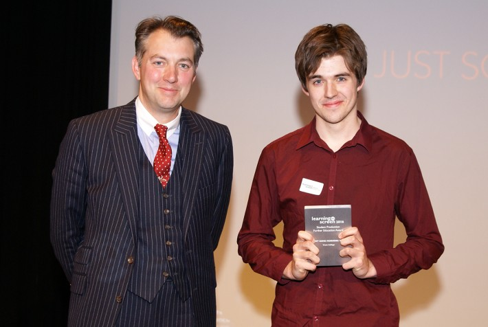 Presenter James Holland with George Summers, Truro College, accepting the FE Student Production Award.